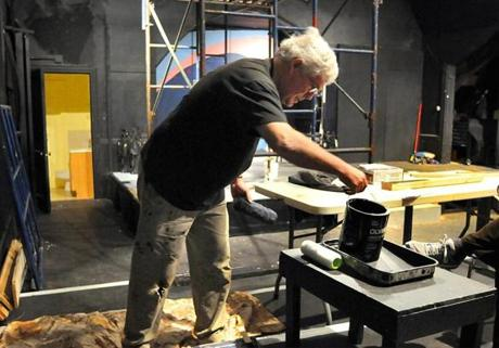 Braintree 4/14/2011- At Curtain Call Theatre in Braintree, member Jonathan Young of Braintree grabs a gallon of paint. Photo by Debee Tlumacki for the Boston Globe(regional) Reporter: Jessica Bartlett