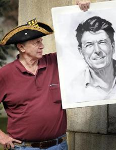 Len Mead of Westborough with a portrait of President Reagan at the Tax Day Tea Party Rally in Worcester.