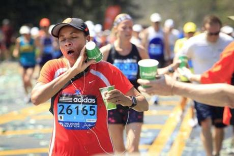 Overheated runners took advantage of a water station at the halfway mark in Wellesley.