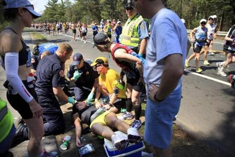 A female runner collapsed at the halfway mark next to Wellesley College Monday. She was immediately taken away on a stretcher by Wellesley fire department staff.