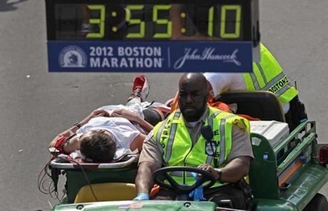A runner was transported across the finish line.