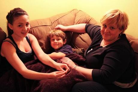 Linda Jerrett (right), with her two children, Nora, 13, and Adam, 7.