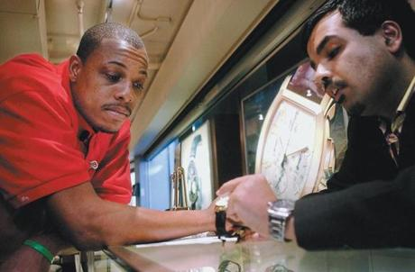 Celtics star Paul Pierce looks at watches with Amit Handa in 2006.