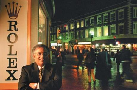 Raman Handa poses outside the Alpha Omega flagship in Harvard Square in 2002.