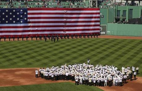 SLIDER -- 04/20/2012 BOSTON, MA Former Red Sox players, coaches and managers take the field during a celebration of Fenway Park's (cq) 100th anniversary. (Aram Boghosian for The Boston Globe)