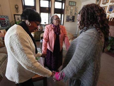 Betty Williams (top left), the Rev. Gracie Redfearn, and Barbara Ravenell prayed at Charles Street AME Church.