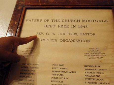 A document honoring the ''Payers of the Church Mortgage Debt Free in 1943'' hangs on the walls.