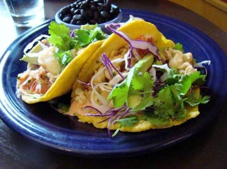 HOME KITCHEN CAFE Lobster tacos come with black beans, avocado, red cabbage slaw, and cilantro.