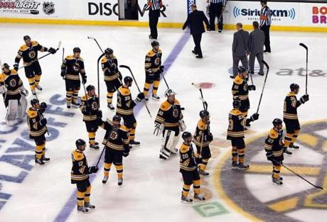 Bruins players saluted the fans at the end of the game.