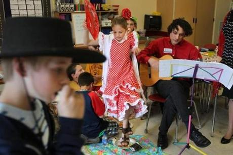 A fiesta for fourth-graders in Clyde Brown Elementary's Spanish immersion class fea-tured a performance by (from left) Andrew Schutze, Haley Lederer and Antonio Viana.