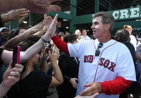 Former Red Sox first baseman Bill Buckner, greeting fans under the bleachers during the centennial celebration for Fenway Park, April 20, 2012.
