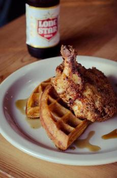 The eclectic menu includes chicken and waffles.