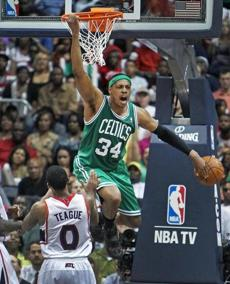Paul Pierce screams in delight — much to the chagrin of Atlanta's Jeff Teague — after a fourth-quarter dunk.