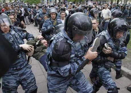 Riot police detained an opposition supporter during an unsanctioned protest in Moscow.