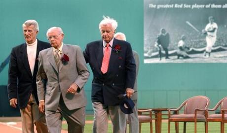 Pesky, left, maintained a lifelong friendship with Williams, and mourned him at the 2002 service the Red Sox held marking the left fielder's death. With Pesky were Dominic DiMaggio, right, and former broadcaster Curt Gowdy.