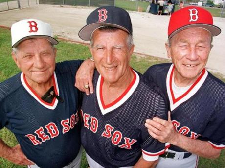 Pesky, center, helped continue a tradition of longtime Red Sox coaches such as Eddie Popowski, left, and Charlie Wagner (shown in 1997) becoming fixtures at spring training.