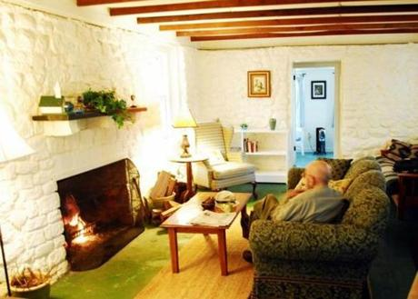 The fireplace in the living area is the cottage's sole source of heat.