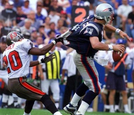 Buccaneers cornerback Ronde Barber had Patriots quarterback Drew Bledsoe in his grasp on this play.
