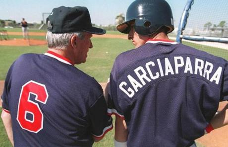 Pesky became a fixture at spring training, where he worked with young players. Here, he conferred with Nomar Garciaparra in 1995.