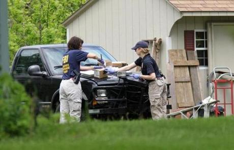 Law enforcement officials searched the home of Robert Gentile Thursday in Manchester, Conn.