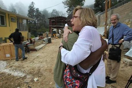 Filis Casey, of Newton, saw the house nearly completed for the first time as she greeted Pastor Maxime for the first time since her original trip a year ago.