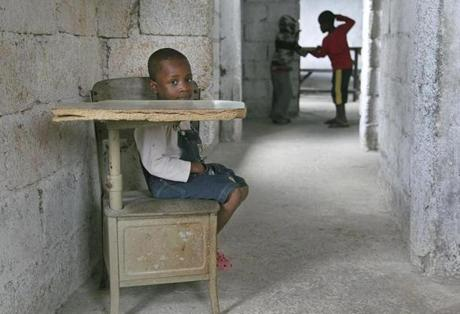 As often happens, the teacher did not arrive to teach for the kids. Dieuvenson, 3, sat in a corner of the classroom, while children played.