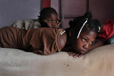 Roselaure, 10, and Rosemene, 8, whiled away an afternoon in the orphanage.