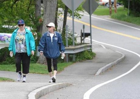 Donna Picone (left) and Patti Lynch follow Route 62 for their recent 9½-mile trek to visit with North Reading's firefighters.