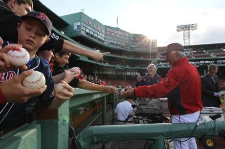 Boston, MA - 05/11/12 - Boston Red Sox manager Bobby Valentine (25) signing autographs before the start of today's game against the Cleveland Indians. The Boston Red Sox took on the Cleveland Indians at Fenway Park. - (Globe Staff Photo / Barry Chin), section: Sports, reporter: Peter Abraham, slug: 12Indians-Red Sox. LOID: 5.0.1196019591.