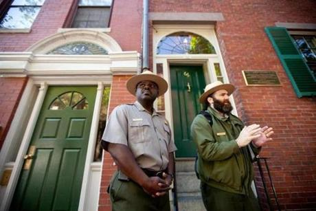 Parks superintendent Cassius Cash and ranger Ryan McNabb stood outside the Lewis and Harriet Hayden House, where Lewis Hayden, a fugitive slave and leading abolitionist, lived.