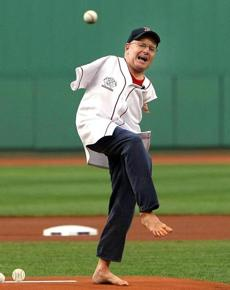 Tom Willis, of San Diego, born without arms and hands, throws out the first pitch with his bare foot. This is the twelfth Major League Baseball field whe
