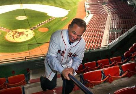 The Boston Red Sox introduced their new manager, Bobby Valentine, at a press conference at Fenway Park. He slides down a railing in the stands outside the State Street Pavillion. (Dec. 1, 2011)