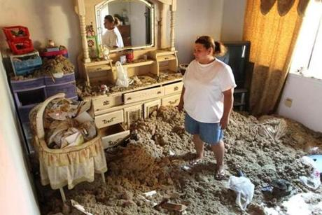 A devastating tornado moved though Springfield, causing widespread destruction. Zoraida Sanchez stands in a second floor room filled with attic insulation. The crib held her grandson, Nathan, 4 months old, when the tornado hit. The baby was not injured. The apartment is located in the Hickory Street projects. (June 3, 2011)