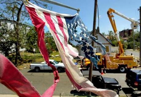 A tattered flag hangs from a destroyed home on Eastern Ave. in Springfield. (June 3, 2011)