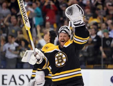 Bruins' goalie Tim Thomas waves to fans following a win in overtime, game 7 of the Eastern Conference quarterfinals. (April 27, 2011)