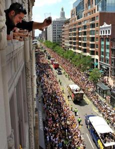 Kostas Klokelis, of Framingham, salutes the duck boats during the rolling rally, from the Karmloop office on Boylston Street where he works. (June 18, 2011)