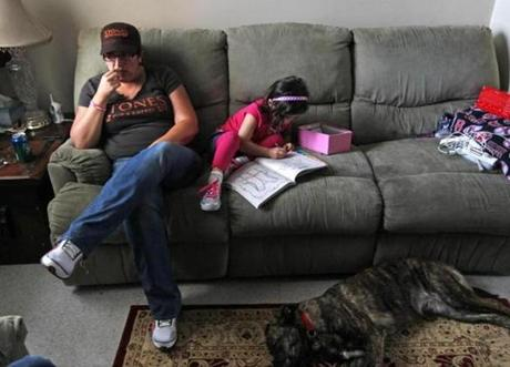 Gloucester, MA - 5-16-12 - Allison Hammond (cq) sits in her apartment with daughter Lizzie (cq) during the long wait for word/body of her missing daughter Caleigh Harrison (cq). (Globe staff photo / Bill Greene) section:g, reporter:english, Topic: harrison
