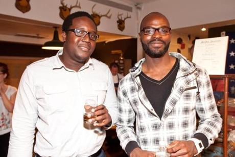 5/17/12 Boston, MA -- From left, Ondre Daniel of Allston and Gabriel Ajayi of Salem at the opening celebration for Ball and Buck, a men's clothing and lifestyle retail shop on Newbury St. May 17, 2012. Erik Jacobs for the Boston Globe