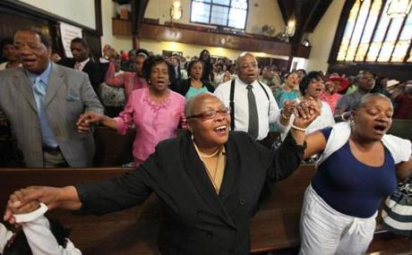 Near the end of service, the congregation at Grant AME Church, where Donna Summer once worshipped, held hands and sang. May 20, 2012.