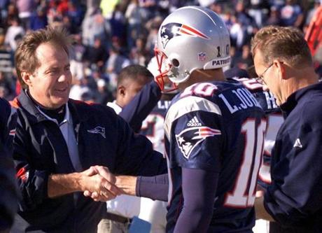 Bill Belichick celebrated after the win with punter/holder Lee Johnson, who converted a pass on a fake late in the game.