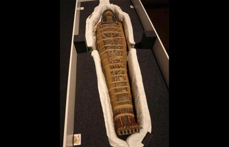 The mummy had to be unpacked from its protective case.