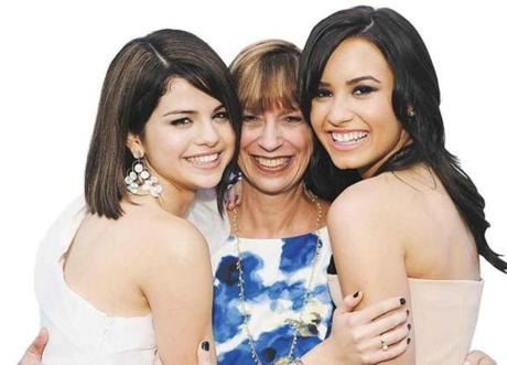 Selena Gomez, Disney casting executive Judy Taylor, and Demi Lovato at a 2009 movie premiere.
