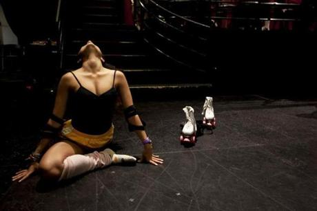 Claudia Yanez stretched before a dress rehearsal for