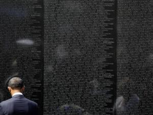 "President Barack Obama stood at ""The Wall"" during a Memorial Day event a the Vietnam Veterans Memorial on the National Mall in Washington, DC."