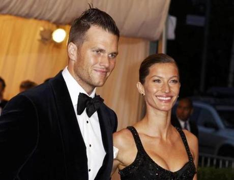 "and Brady said he ""got a lot of grief"" for his hair at a May 7 event, in New York, but added that wife Gisele Bundchen, right, liked his hair."