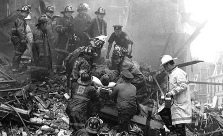June 17, 1972: Firefighters and emergency personnel worked to remove a victim from the rubble left by the fire after a partial building collapse at the Hotel Vendome. Nine firefighters were killed in the collapse of the building, the worst loss of life in the history of the Boston Fire Department.