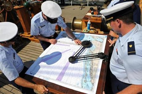 Cadets on the USCG Barque Eagle, a training ship, chart navigation routes on May 28, 2012, while leaving New York Harbor in route to Norfolk, VA.