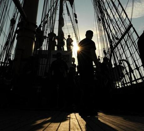 Members of the USCG Barque Eagle, a training ship, on deck while leaving New York Harbor in route to Norfolk, VA.