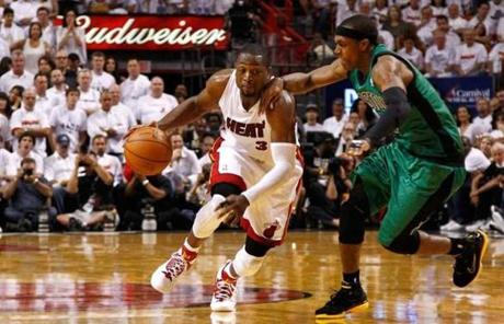 Dwyane Wade  drove against Rondo in the second half. After a slow start, Wade finished with 23 points.