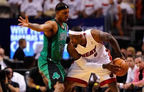 LeBron James looked to pass the ball as Paul Pierce put on close pressure.